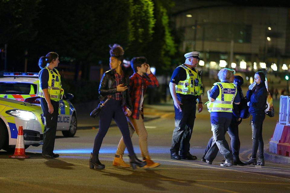 <p>Police and fans close to the Manchester Arena on May 23, 2017 in Manchester, England. There have been reports of explosions at Manchester Arena where Ariana Grande had performed this evening. Greater Manchester Police have have confirmed there are fatalities and warned people to stay away from the area. (Dave Thompson/Getty Images) </p>