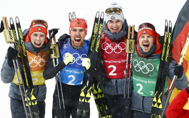 Nordic Combined Events - Pyeongchang 2018 Winter Olympics - Men's Team 4 x 5 km Final - Alpensia Cross-Country Skiing Centre - Pyeongchang, South Korea - February 22, 2018 - Johannes Rydzek of Germany celebrates with teammates Vinzenz Geiger, Fabian Riessle and Eric Frenzel after winning the gold medal. REUTERS/Dominic Ebenbichler