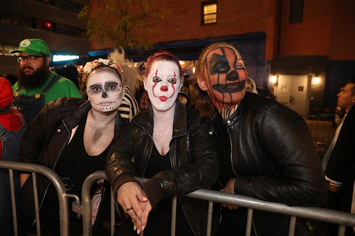 People dressed as goblins and killer clowns wait for the start of the Halloween Parade in New York City. (Photo: Gordon Donovan/Yahoo News)
