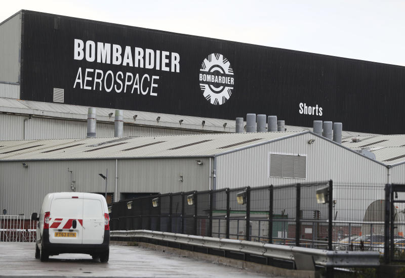 "FILE - This is a Sept. 13, 2017 file photo of the Bombardier Aerospace plant in Belfast, Northern Ireland. U.K. Prime Minister Theresa May is ""bitterly disappointed"" by the U.S. government's decision to slap duties of nearly 220 percent on Canada's Bombardier C series aircraft. May took to Twitter on Wednesday Sept. 27, 2017 to say Britain will continue to work with the company to try to protect jobs, including some 4,000 in Northern Ireland. May has a key alliance with the Northern Ireland-based Democratic Unionist Party. (Brian Lawless/PA, File via AP)"
