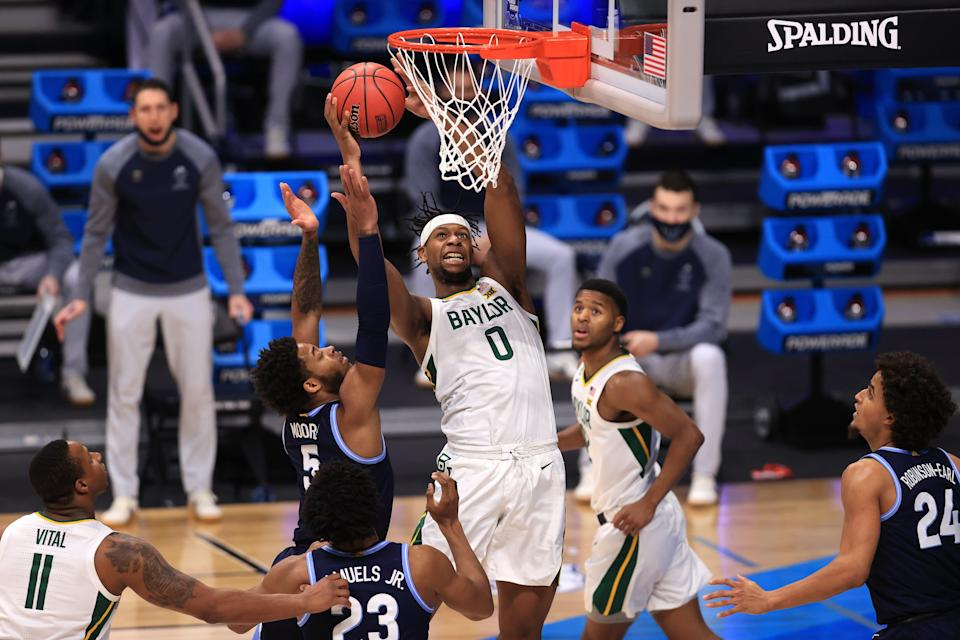 Baylor forward Flo Thamba shoots the ball against Villanova guard Justin Moore during a Sweet 16 matchup in the 2021 NCAA Tournament at Hinkle Fieldhouse.