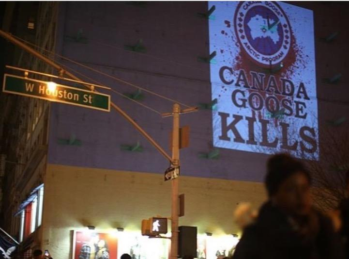 A projection is cast on Houston Street in SoHo, Manhattan, close to the Canada Goose flagship store. (Photo: Courtesy of Rob Banks)