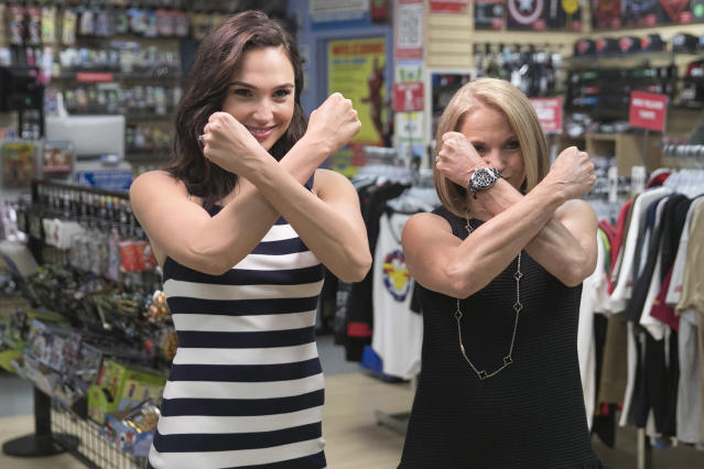 <p>Actress Gal Gadot and Yahoo Global News Anchor Katie Couric shield themselves with Wonder Woman's bracelets at the Midtown Comics in New York City. (Gordon Donovan/Yahoo News) </p>