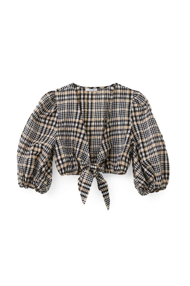 "<p><span>Introducing Instagram's must-have garment this season. The checked crop has adorned the backs of many an influencer and for good reason. Invest in the cult piece and it'll see you through every season. Simply team with high-waisted trousers and a shearling coat come winter.</span><br /><em><span><a rel=""nofollow"" href=""http://www.ganni.com/en/charron-top/F1823.html?dwvar_F1823_color=Cuban%20Sand#page=3-10&start=46"">Ganni</a>, £140</span></em> </p>"
