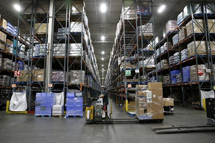 """Associates fill orders for Ralphs and Food 4 Less grocery stores at the Ralphs Distribution Center in Riverside. <span class=""""copyright"""">(Gary Coronado / Los Angeles Times)</span>"""