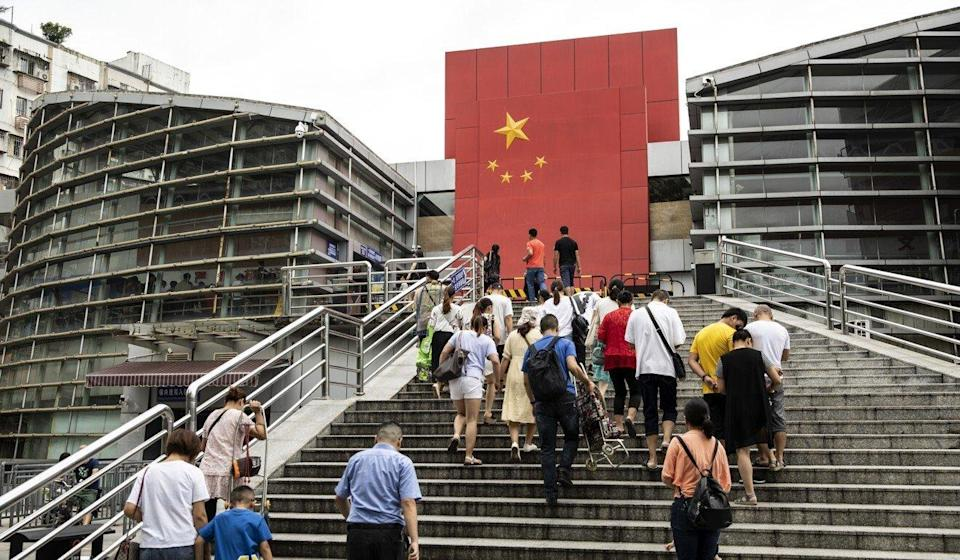People walk up steps at a border crossing facility in Shenzhen, which is part of the Greater Bay Area. Photo: Bloomberg