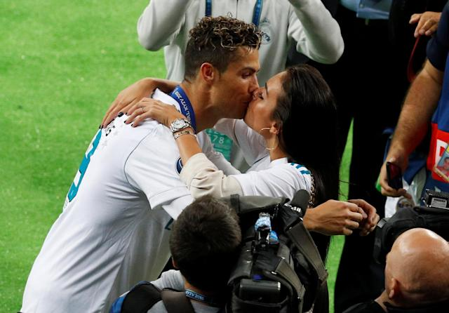 Soccer Football - Champions League Final - Real Madrid v Liverpool - NSC Olympic Stadium, Kiev, Ukraine - May 26, 2018 Real Madrid's Cristiano Ronaldo celebrates with his girlfriend Georgina Rodriguez after winning the Champions League REUTERS/Phil Noble