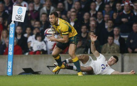 Rugby Union - England v Australia - QBE International - Twickenham Stadium - 29/11/14 Australia's Quade Cooper (L) in action Mandatory Credit: Action Images / Paul Harding
