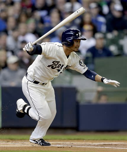 Milwaukee Brewers' Norichika Aoki runs out a hit against the Chicago White Sox during the first inning of an exhibition baseball game, Saturday, March 30, 2013, in Milwaukee. (AP Photo/Jeffrey Phelps)