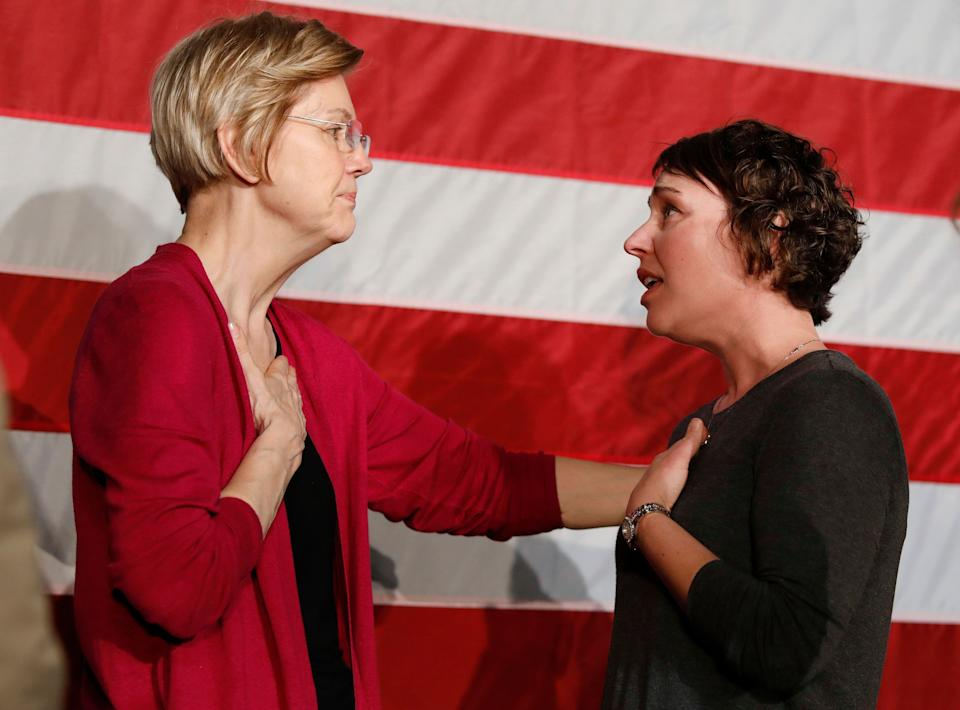 Sen. Elizabeth Warren, D-Mass., left, talks with Christa Lautner, right, of Urbandale about student loans and predatory lending after an organizing event at Curate event space in Des Moines, Iowa, on Saturday, Jan. 5, 2019. (AP Photo/Matthew Putney)