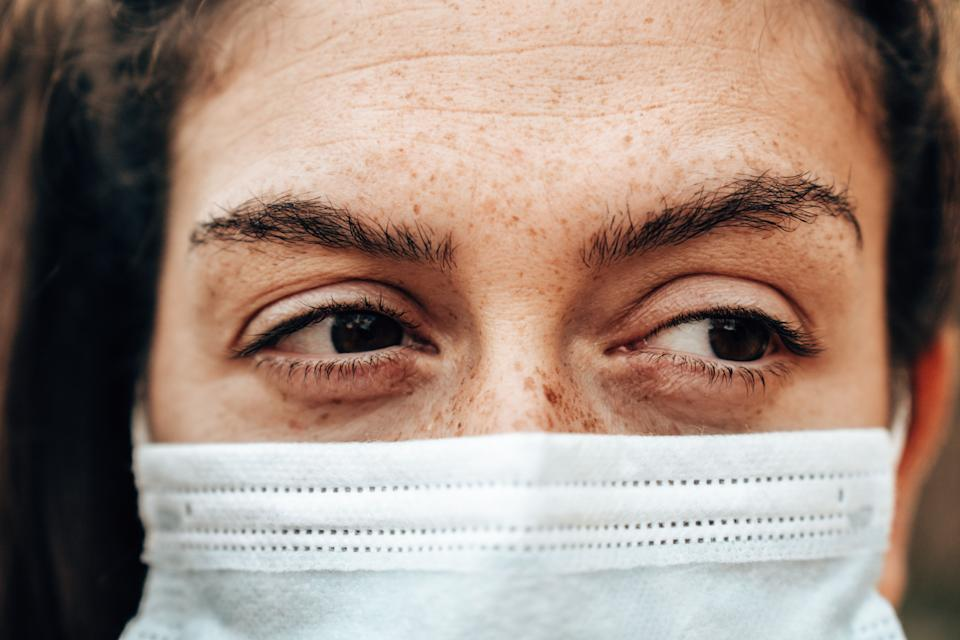 sad woman eyesight with face mask during the covid (Photo: franckreporter via Getty Images)