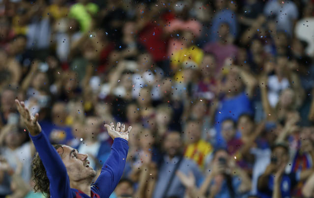 Barcelona's Antoine Griezmann celebrates after scoring his side's second goal during the Spanish La Liga soccer match between FC Barcelona and Betis at the Camp Nou stadium in Barcelona, Spain, Sunday, Aug. 25, 2019. (AP Photo/Joan Monfort)
