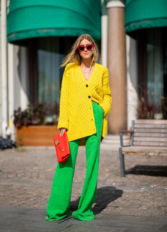 <p>Go bright with an oversized cardigan and contrasting pants in an equally bold hue.</p>