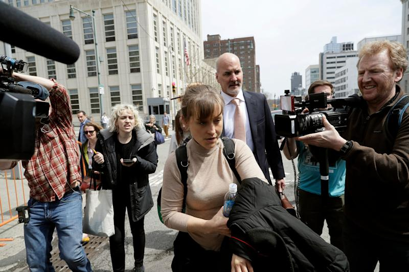 Actress Allison Mack leaves Brooklyn federal court Monday, April 8, 2019, in New York. Mack pleaded guilty to racketeering charges on Monday in a case involving a cult-like group based in upstate New York. The trial is expected to detail sensational allegations that the group, called NXIVM, recruited sex slaves for its spiritual leader, Keith Raniere.(AP Photo/Mark Lennihan)