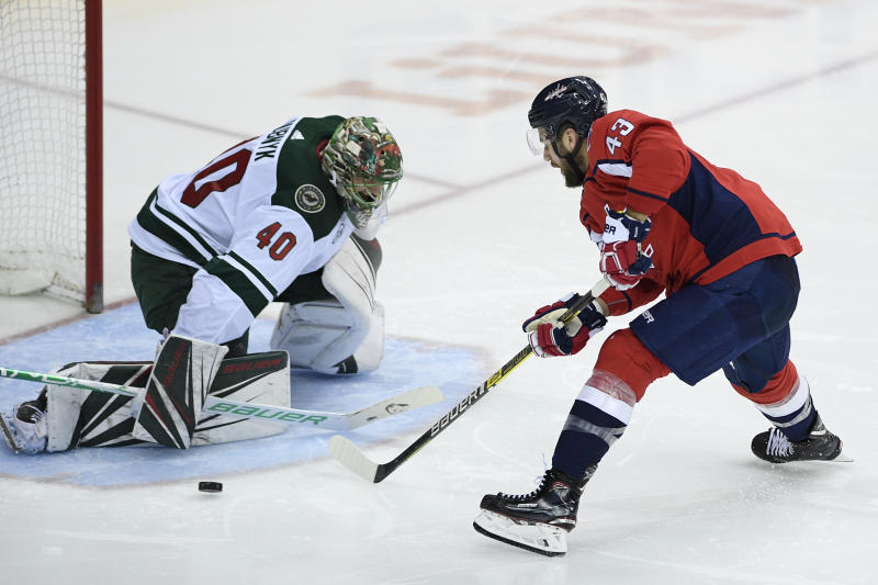 Washington Capitals right wing Tom Wilson (43) skates with the puck against Minnesota Wild goaltender Devan Dubnyk (40) during the third period of an NHL hockey game Friday, March 22, 2019, in Washington. The Wild won 2-1. (AP Photo/Nick Wass)