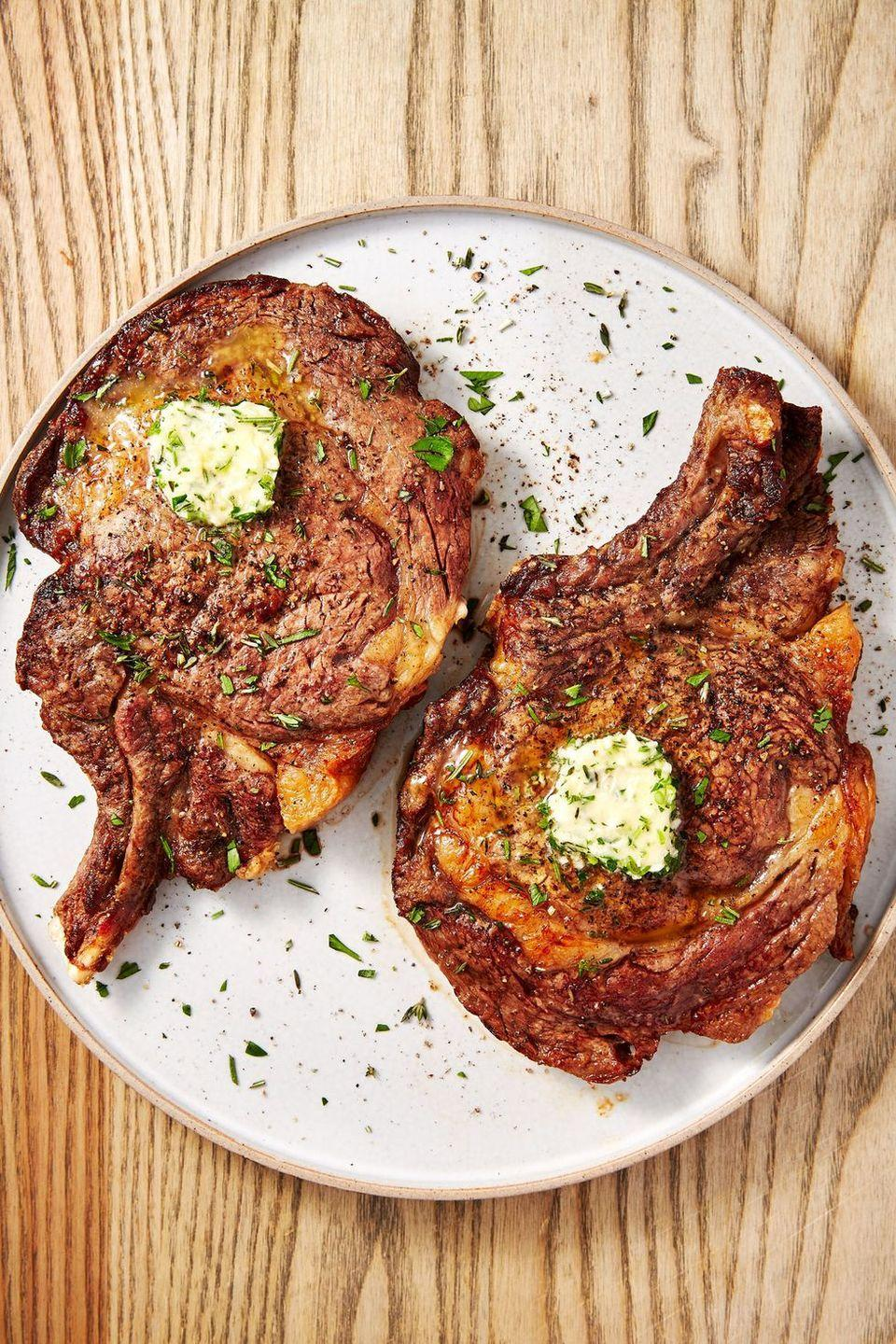 """<p>A <a href=""""https://www.delish.com/uk/cooking/recipes/a30252481/how-to-pan-fry-steak/"""" rel=""""nofollow noopener"""" target=""""_blank"""" data-ylk=""""slk:perfectly seared steak"""" class=""""link rapid-noclick-resp"""">perfectly seared steak</a> can seem like a daunting task. Getting the golden, crusty sear on the outside and trying not to overcook your steak can be difficult. </p><p>What if we told you that your air fryer can take all of that stress away? It's true! Leave it to the air fryer to cook a perfect piece of steak all without filling your kitchen with smoke or turning on the grill. As for the herb butter? It's not mandatory, but it sure is delicious. </p><p>Get the <a href=""""https://www.delish.com/uk/cooking/recipes/a32284104/air-fryer-steak-recipe/"""" rel=""""nofollow noopener"""" target=""""_blank"""" data-ylk=""""slk:Air Fryer Steak"""" class=""""link rapid-noclick-resp"""">Air Fryer Steak</a> recipe.</p>"""