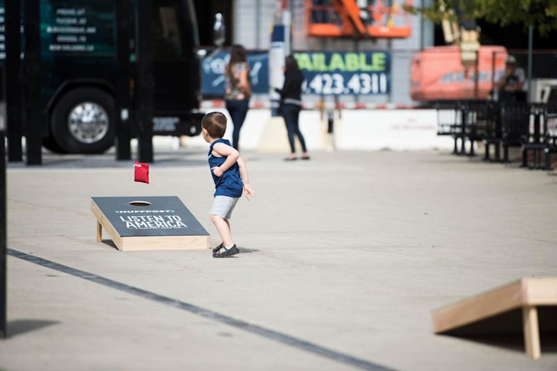 Peter Daining (not pictured) and his son Teddy play cornhole.