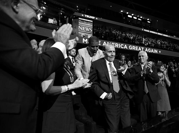 <p>Indiana Gov. Mike Pence, right, applauds former Senate Majority Leader Bob Dole, center, at the Republican National Convention on Monday. (Photo: Khue Bui for Yahoo News)</p>