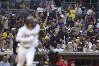 Fans stand up to cheer a home run by San Diego Padres' Fernando Tatis Jr. against the Cincinnati Reds during the sixth inning of a baseball game Thursday, June 17, 2021, in San Diego. (AP Photo/Derrick Tuskan)
