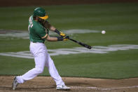 Oakland Athletics' Chad Pinder hits a two-run home run against the Houston Astros during the seventh inning of a baseball game Friday, April 2, 2021, in Oakland, Calif. (AP Photo/Tony Avelar)