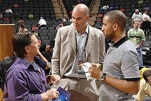 Former Cavs GM Danny Ferry (center) never wanted to fire coach Mike Brown, but owner Dan Gilbert (left) knew LeBron James and his business manager Maverick Carter (right) wanted Brown out as far back as 2009