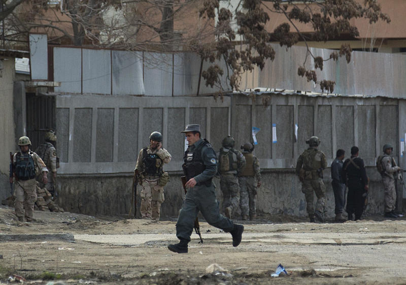 "Afghan police and special forces surround the area after four suicide bombers armed with assault rifles and hand grenades attacked an ""office of foreigners"" in a southwestern neighborhood of Kabul, Afghanistan, Friday, March 28, 2014. A Taliban spokesman said insurgents attacked a ""guest house of foreigners and a church of foreigners."" His claim could not be immediately confirmed. (AP Photo/Anja Niedringhaus)"