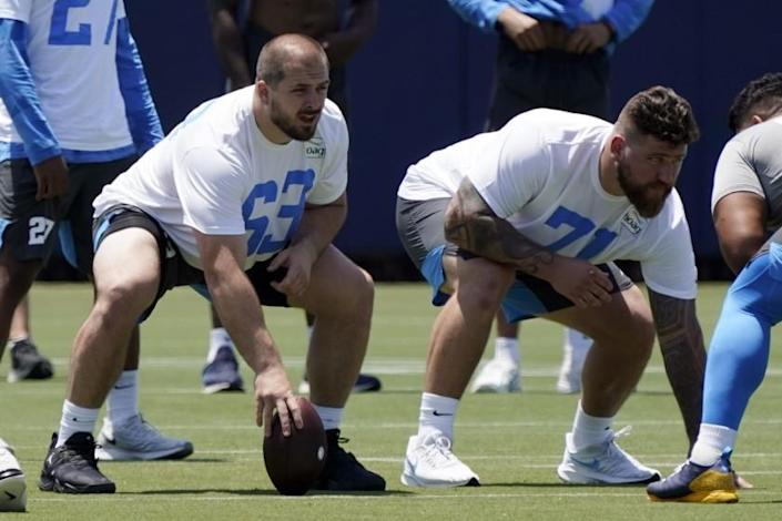 Chargers center Corey Linsley and guard Matt Feiler line up during practice in Costa Mesa.