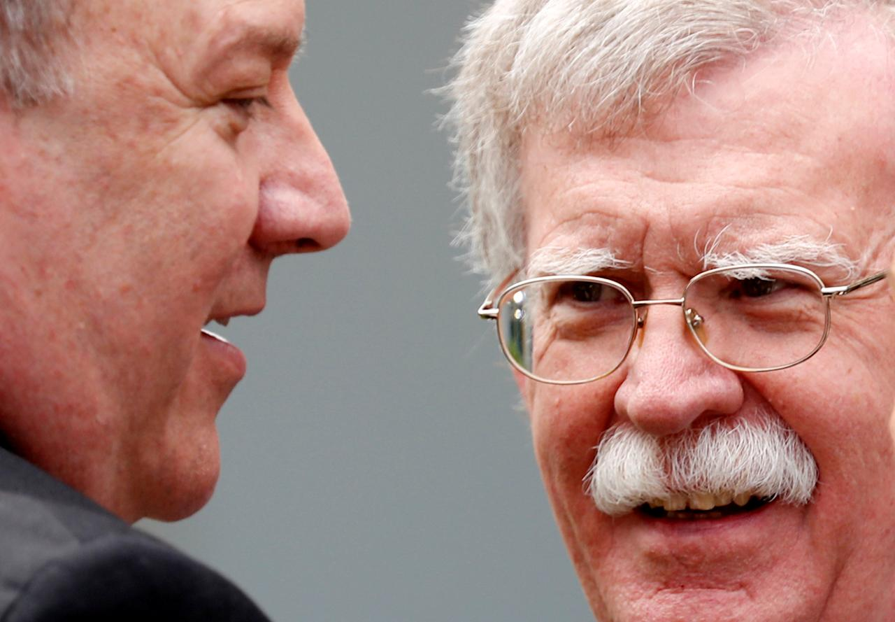 FILE PHOTO: U.S. Secretary of State Mike Pompeo talks with national security adviser John Bolton in the Rose Garden of the White House in Washington, DC, U.S., June 7, 2018. REUTERS/Kevin Lamarque/File Photo