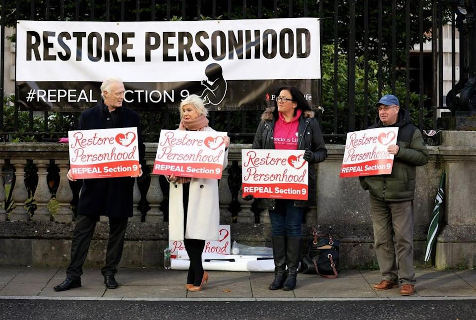 Anti Abortion and pro life members hold a protest outside Belfast High Court. (Peter Morrison/PA) (PA Wire)