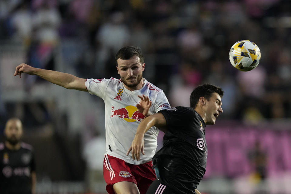 New York Red Bulls defender Thomas Edwards, left, clashes with Inter Miami forward Robbie Robinson during the first half of an MLS soccer match Friday, Sept. 17, 2021, in Fort Lauderdale, Fla. (AP Photo/Rebecca Blackwell)