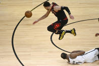 Chicago Bulls guard Zach LaVine, top, chases a ball that was tippled by Brooklyn Nets forward Kevin Durant (7) during the second half of an NBA basketball game Tuesday, May 11, 2021, in Chicago. (AP Photo/Matt Marton)