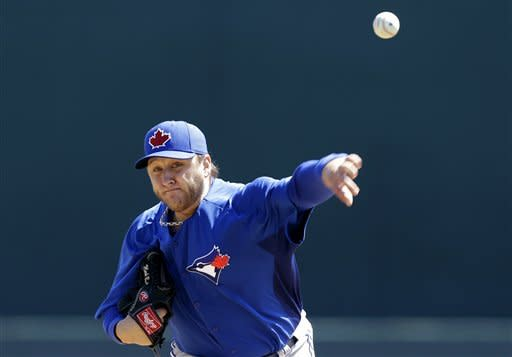 Toronto Blue Jays starting pitcher Mark Buehrle throws during a spring training baseball game against the Baltimore Orioles, Thursday, March 7, 2013, in Sarasota, Fla. (AP Photo/Charlie Neibergall)