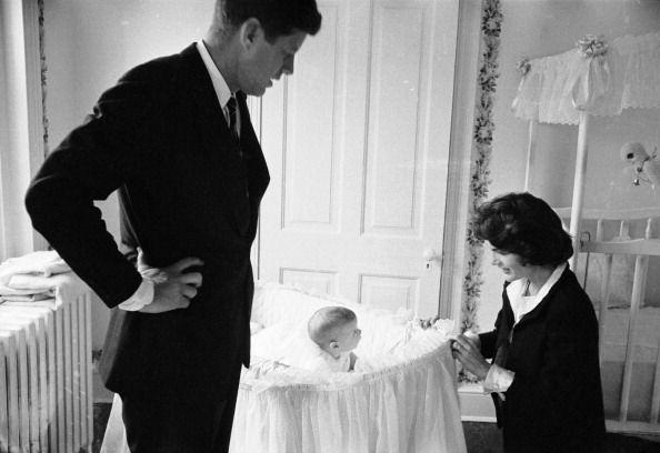 <p>Senator Kennedy and his wife Jackie with their infant daughter Caroline in their Georgetown home. </p>