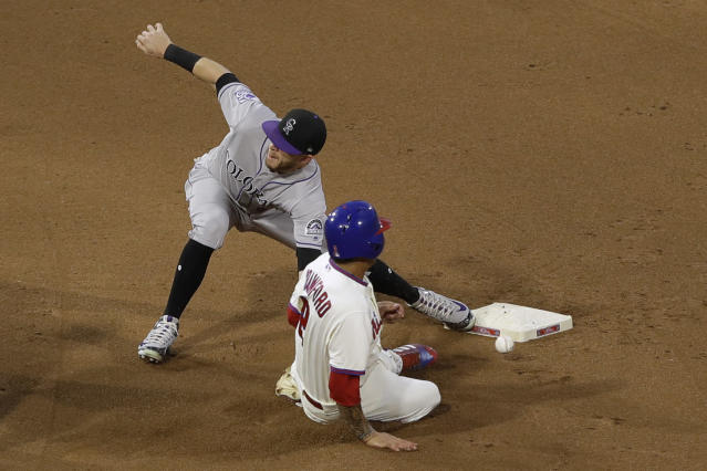 Philadelphia Phillies' J.P. Crawford, front, steals second base past Colorado Rockies shortstop Trevor Story during the fourth inning of a baseball game Tuesday, June 12, 2018, in Philadelphia. (AP Photo/Matt Slocum)