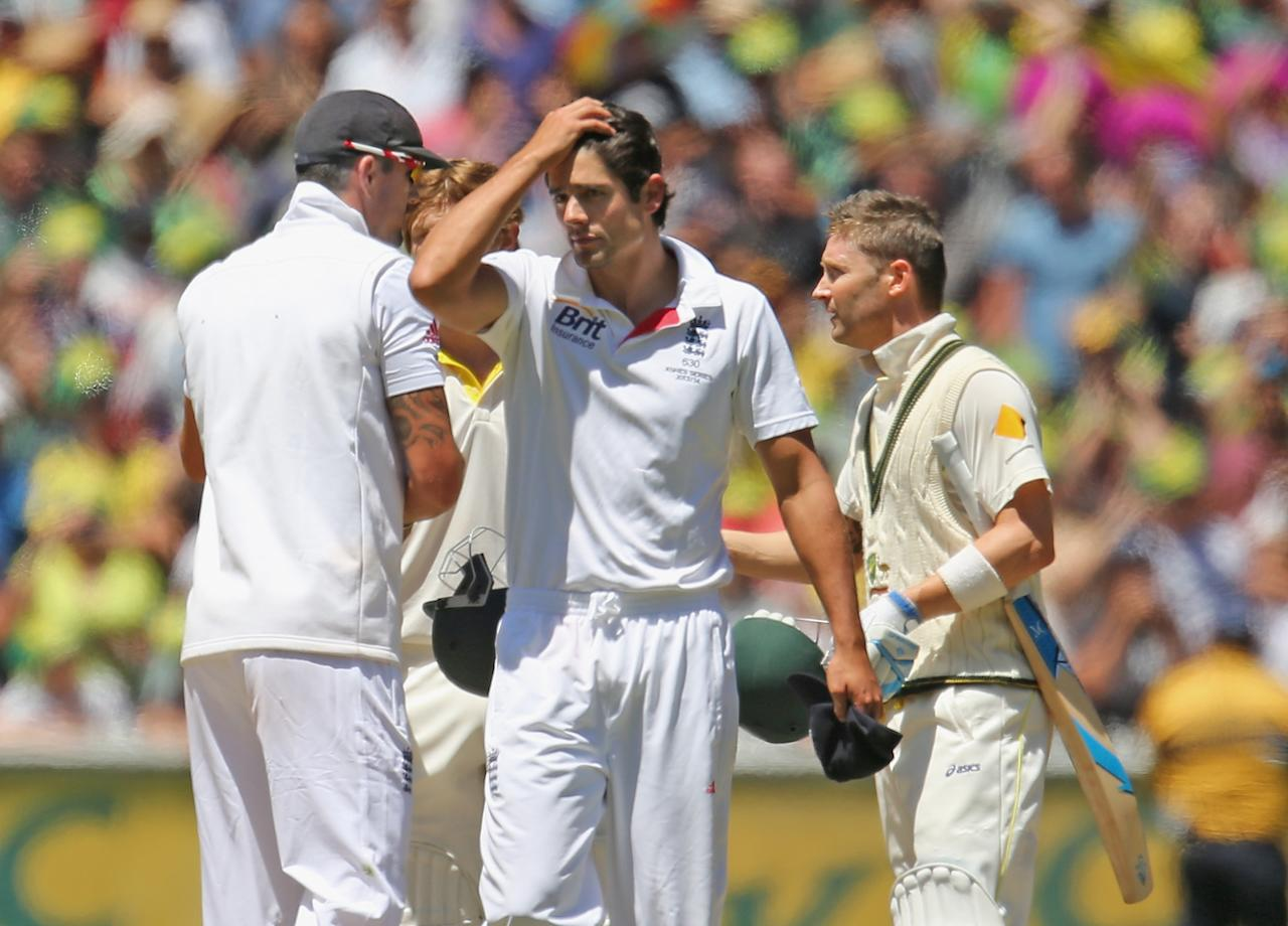 MELBOURNE, AUSTRALIA - DECEMBER 29:  English captain Alastair Cook (C) looks dejected as Australian captain Michael Clarke shakes the hand of Kevin Pietersen of England after Australia won the match during day four of the Fourth Ashes Test Match between Australia and England at Melbourne Cricket Ground on December 29, 2013 in Melbourne, Australia.  (Photo by Scott Barbour/Getty Images)