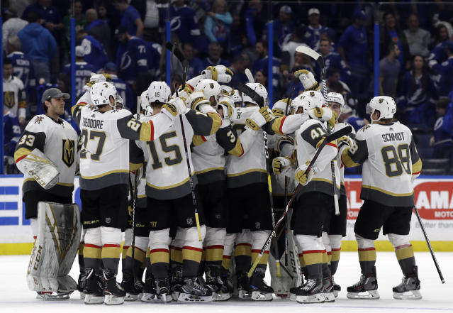 The Vegas Golden Knights celebrate their 3-2 win over the Tampa Bay Lightning during a shootout in an NHL hockey game Tuesday, Feb. 5, 2019, in Tampa, Fla. (AP Photo/Chris O'Meara)