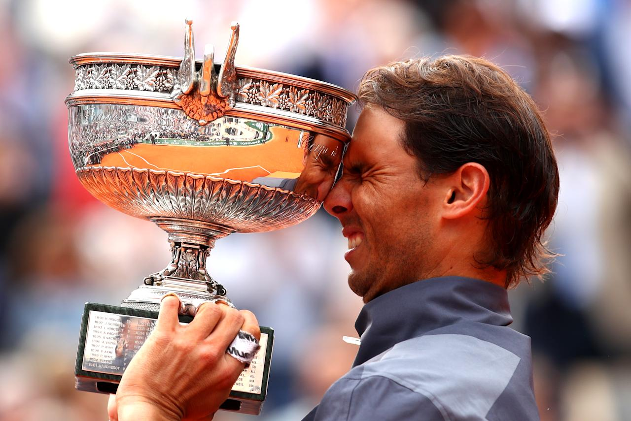 Rafael Nadal of Spain celebrates with the trophy following the mens singles final against Dominic Thiem of Austria during Day fifteen of the 2019 French Open at Roland Garros on June 09, 2019 in Paris, France. (Photo by Clive Brunskill/Getty Images)