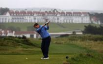 A golfer plays towards the hotel on the Ailsa Championship Course at the Trump Turnberry Golf Resort in Turnberry, Scotland