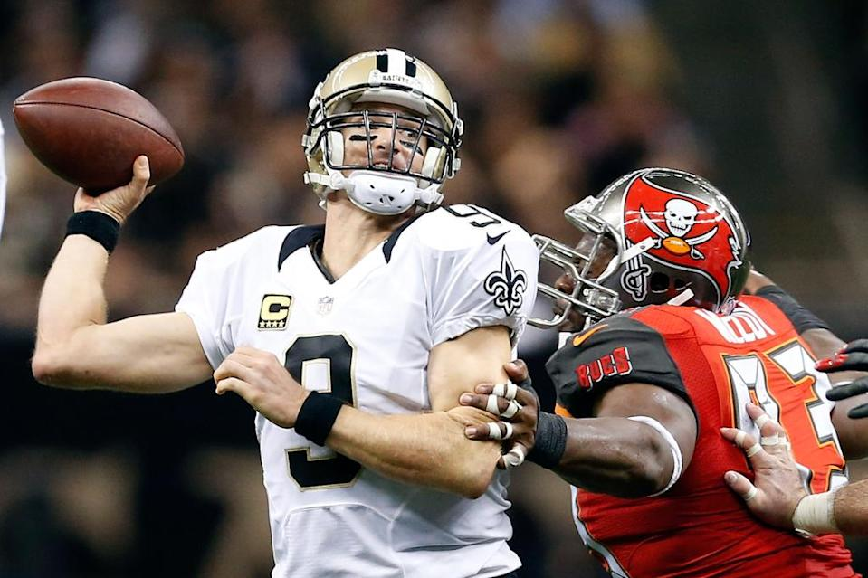 Drew Brees #9 of the New Orleans Saints is pressured by Gerald McCoy #93 of the Tampa Bay Buccaneers during the fourth quarter of a game at the Mercedes-Benz Superdome on September 20, 2015 in New Orleans, Louisiana (AFP Photo/Wesley Hitt)