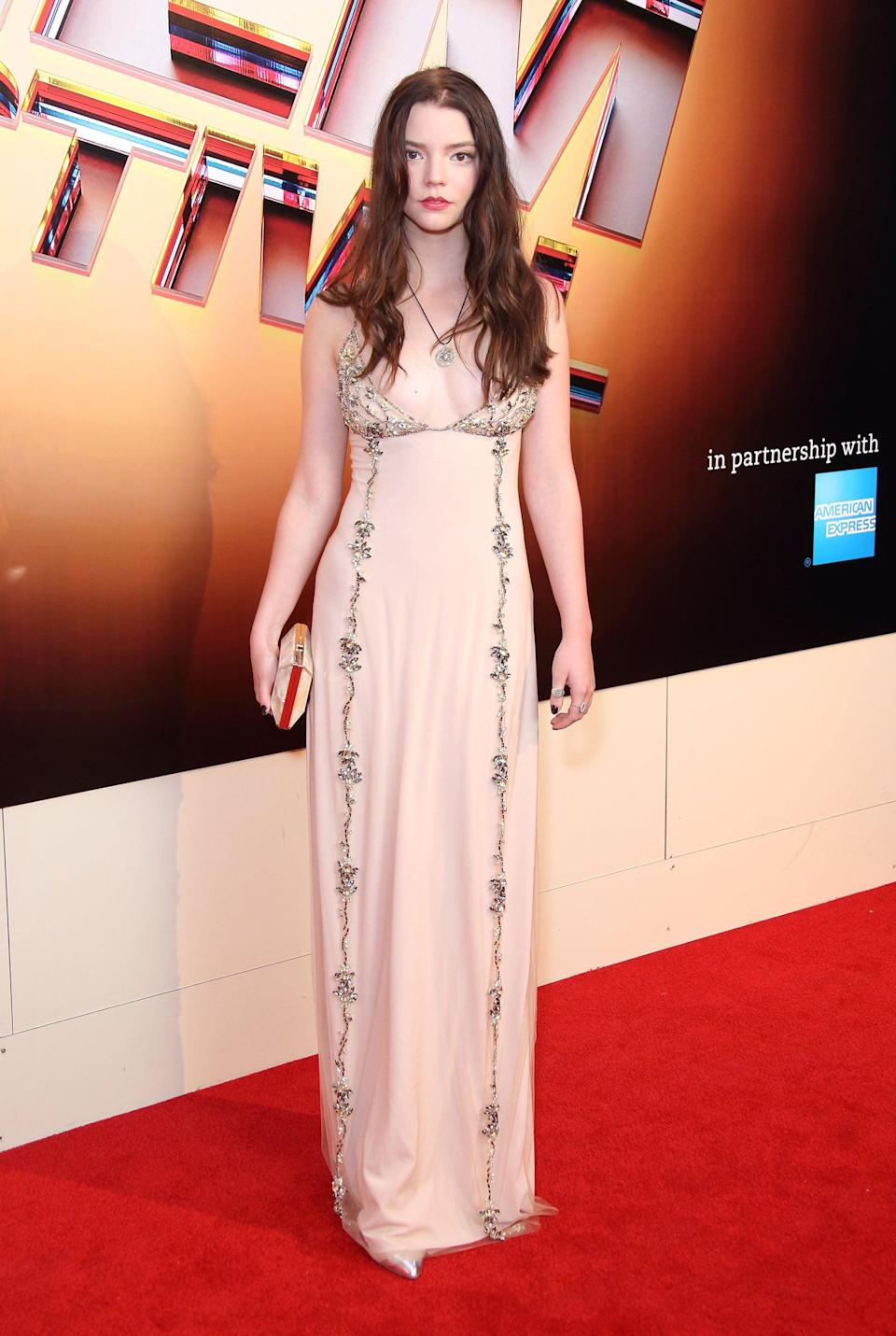 <p>Anya teamed her long dark hair with a slip dress with black embroidery.</p>