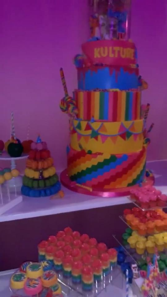 <p>Kulture only turns one once—Cardi B and Offset threw their baby girl a lavish $400,000 birthday party, including a whole table of rainbow-themed sweets. The most impressive? A five-tier Kulture-emblazoned cake towering over the rest of the desserts.</p>