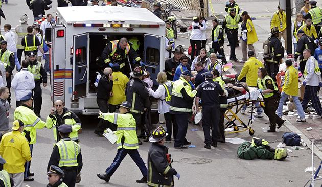 Medical workers help the injured at Boston Marathon (Charles Krupa/AP)
