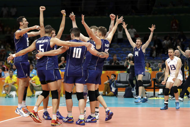 <p>Members of team Italy celebrate following a men's preliminary volleyball match against France at the 2016 Summer Olympics in Rio de Janeiro, Brazil, Sunday, Aug. 7, 2016. Italy won in three sets. (AP Photo/Matt Rourke) </p>