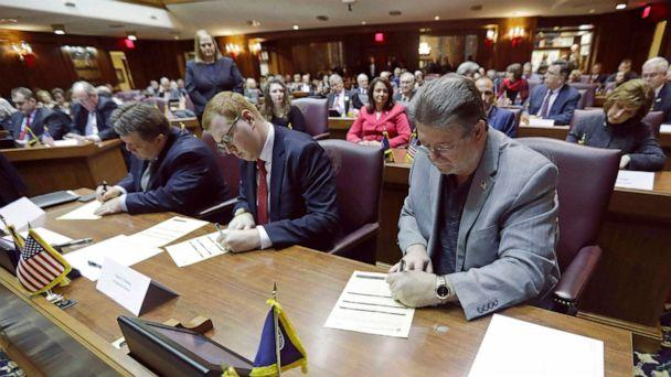 PHOTO: Indiana representatives to the Electoral College sign paperwork to officially cast votes for President-elect Donald Trump at the Statehouse in Indianapolis, Dec. 19, 2016. (Darron Cummings/AP, FILE)