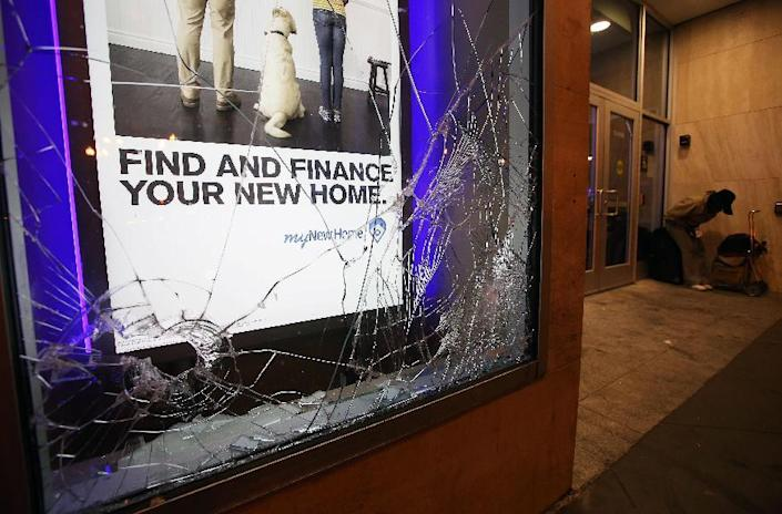 A window is smashed at a Chase Bank in Oakland, Calif., early Sunday, July 14, 2013, following protests after George Zimmerman was found not guilty in the 2012 shooting death of teenager Trayvon Martin. Protesters angered by the acquittal Zimmerman held largely peaceful demonstrations in three California cities, but broke windows and started small street fires Oakland, police said. (AP Photo/Bay Area News Group, Jane Tyska)