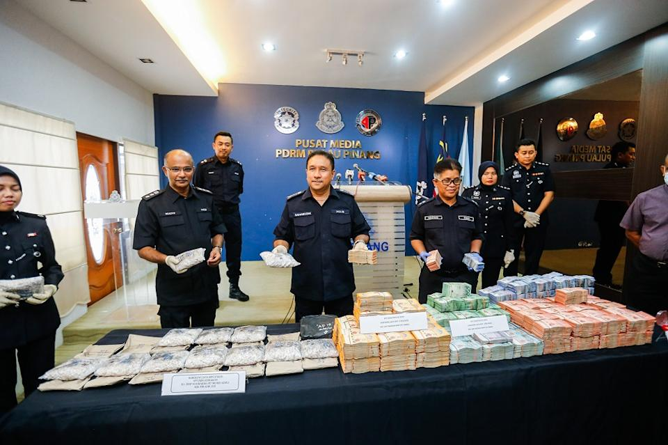 Penang police chief Datuk Sahabudin Abd Manan (centre) showing the drugs and bank notes seized during a drug bust in George Town April 13, 2020. ― Picture by Sayuti Zainudin