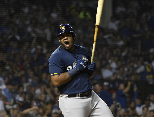 Milwaukee Brewers' Jesus Aguilar (24) reacts after being called out on strikes against the Chicago Cubs during the fourth inning of a baseball game, Tuesday, Sept. 11, 2018, in Chicago. (AP Photo/David Banks)