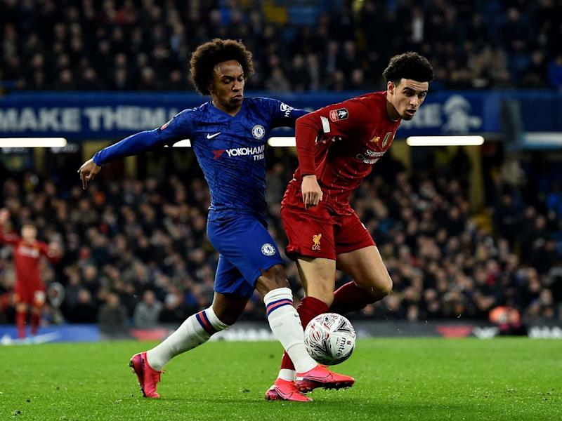 Willian (left) battles for the ball with Liverpool's Curtis Jones: Getty