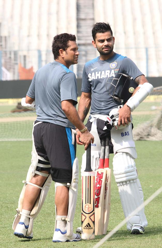 Indian Cricketers Sachin Tendulkar and Virat Kohli during a practice session ahead of test match between India and West Indies starting on Nov 6 at Eden Gardens in Kolkata on Nov.5, 2013. (Photo: IANS)