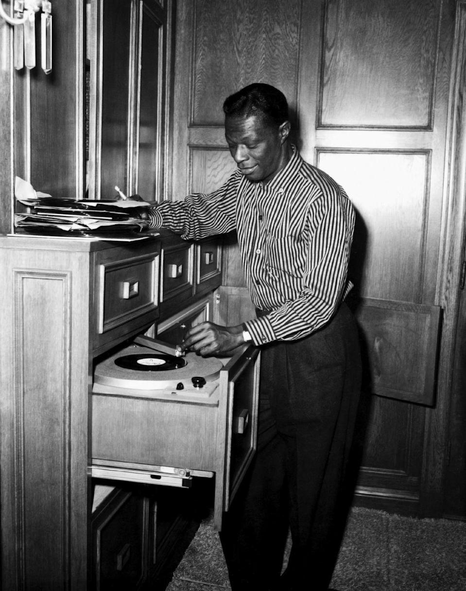 <p>The jazz singer combs through his record collection and picks out a good one for guests in his home. </p>